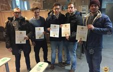 Posing with shooting diplomas